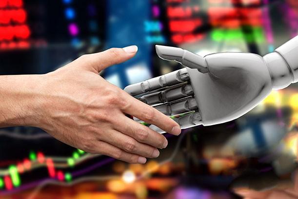 Blog Mein Kollege der Computer Mensch und Roboter geben sich die Hand 611x407px
